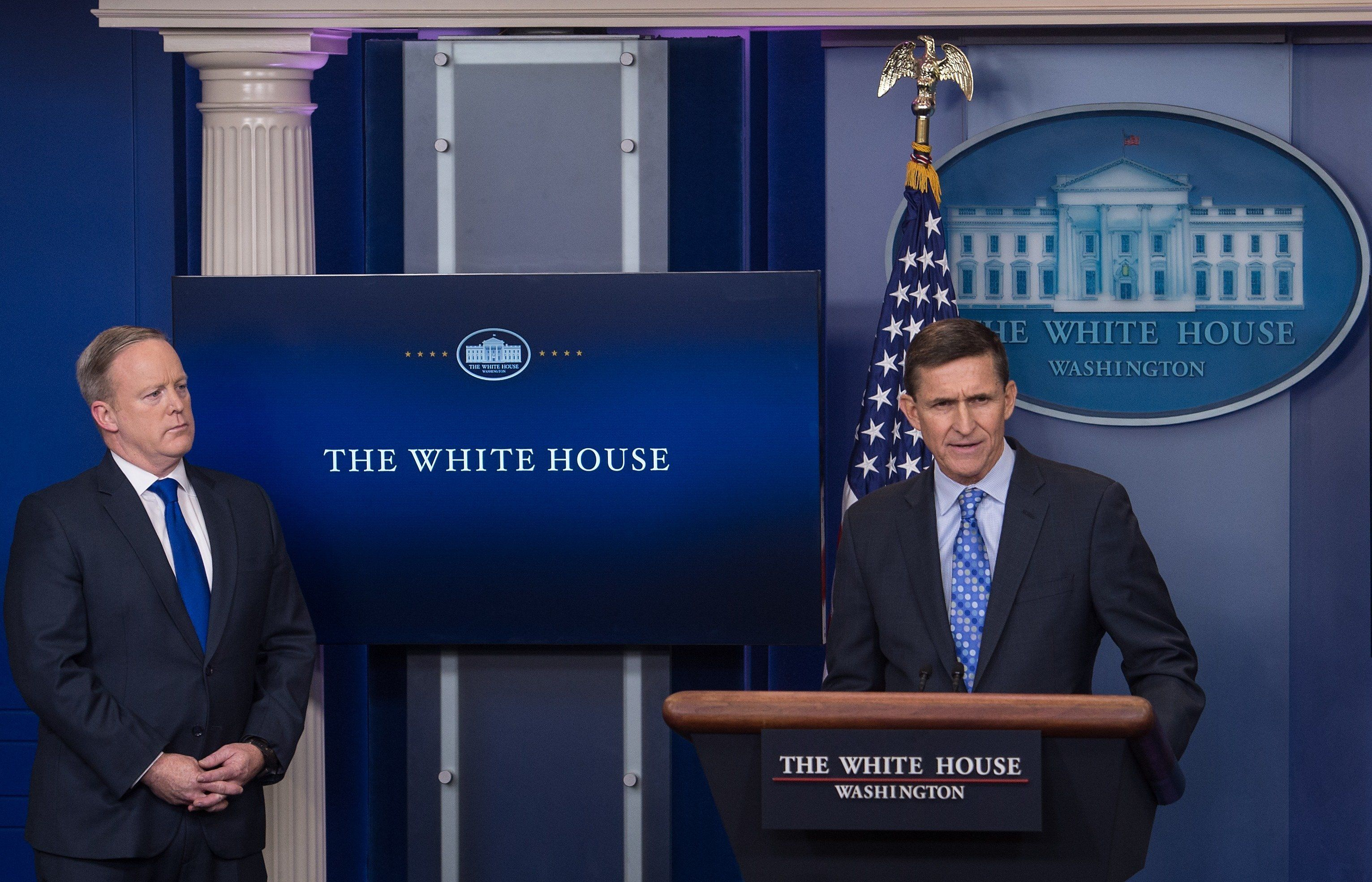 US National Security Adviser Mike Flynn speaks during the daily press briefing as Press Secretary Sean Spicer (L) looks on at the White House in Washington, DC, on February 1, 2017. Flynn signaled a more hardline American stance on Iran Wednesday, condemning a recent missile test and declaring he was 'officially putting Iran on notice.' / AFP / NICHOLAS KAMM        (Photo credit should read NICHOLAS KAMM/AFP/Getty Images)