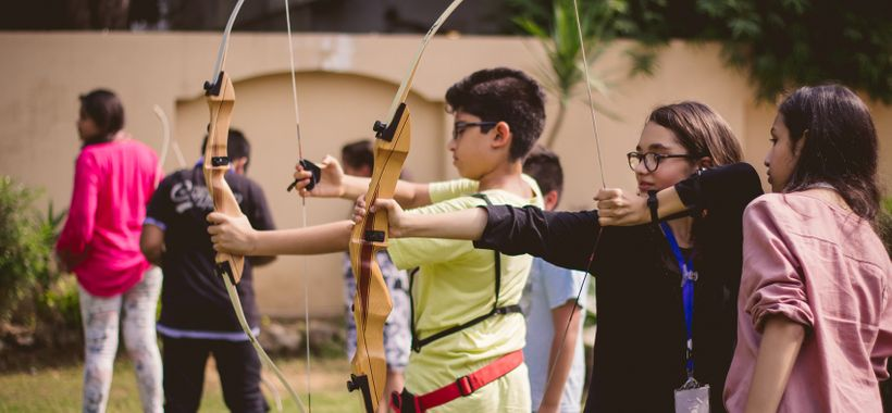 Students at Edopia prepare for an archery lesson.