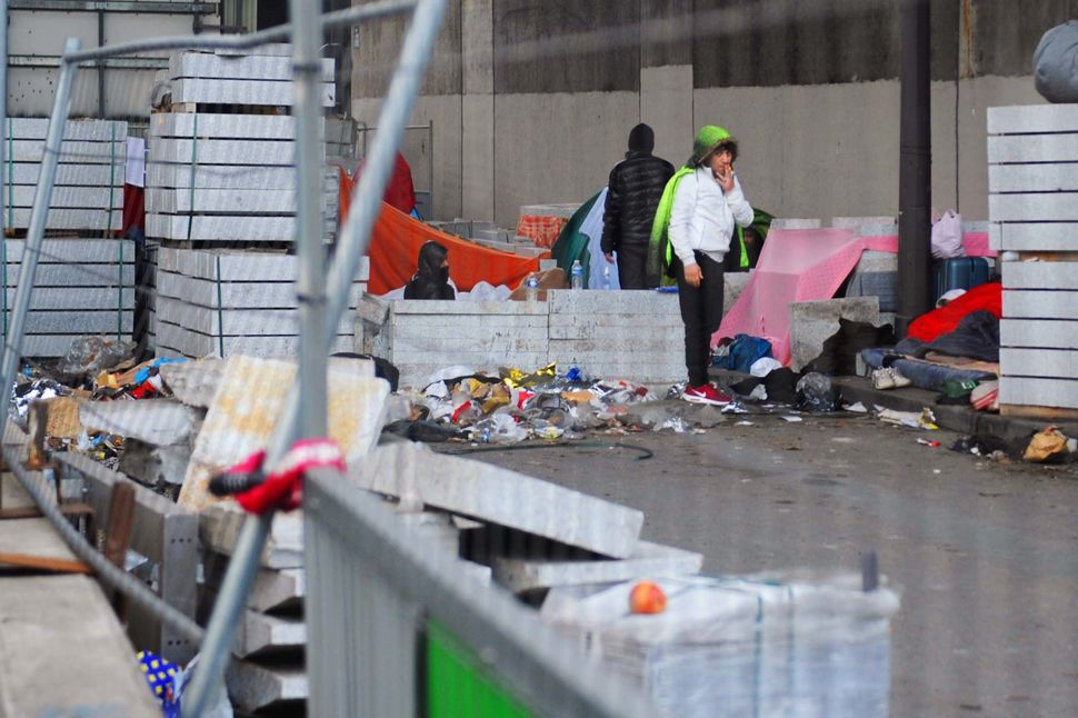 This encampment, beneath a highway in Paris, France, is home to about 60 people, volunteers say.