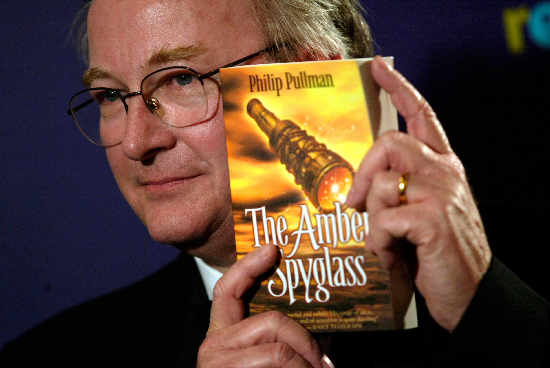"Pullman holding upthe final installment of the ""His Dark Materials"" trilogy."