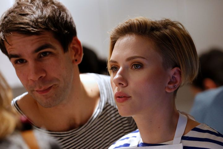 Scarlett Johansson and Romain Dauriac at the opening of the Yummy Pop gourmet popcorn shop in the Marais district of Par