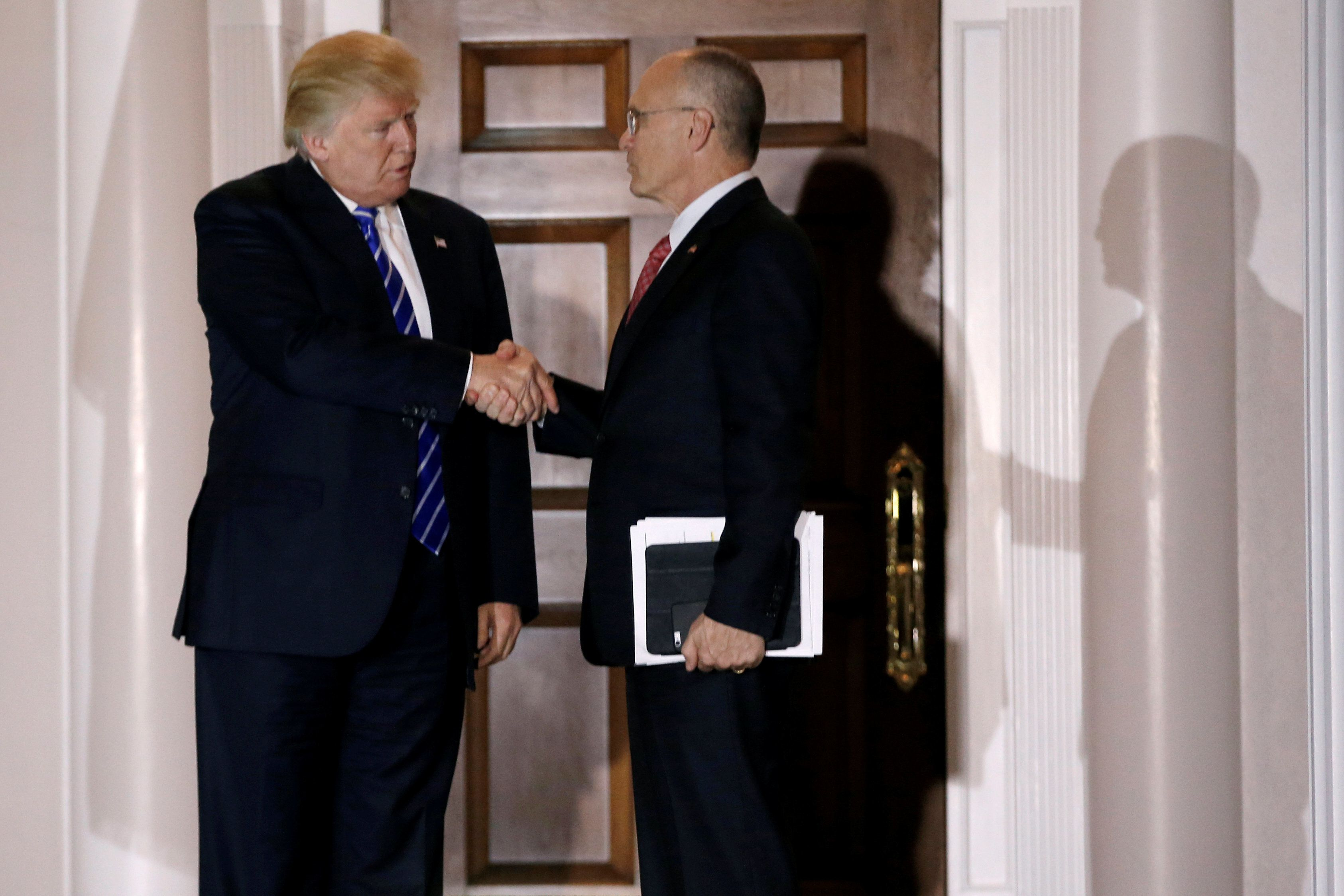 Andy Puzder, CEO of CKE Restaurants, shakes hands with U.S. President-elect Donald Trump after their meeting at the main clubhouse at Trump National Golf Club in Bedminster, New Jersey, U.S., November 19, 2016.  REUTERS/Mike Segar