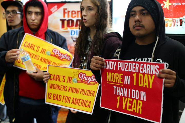 Fast-food workers in Los Angeles take part in nationwide protests to denounce Donald Trump's nomination of Andy Puzder, a res