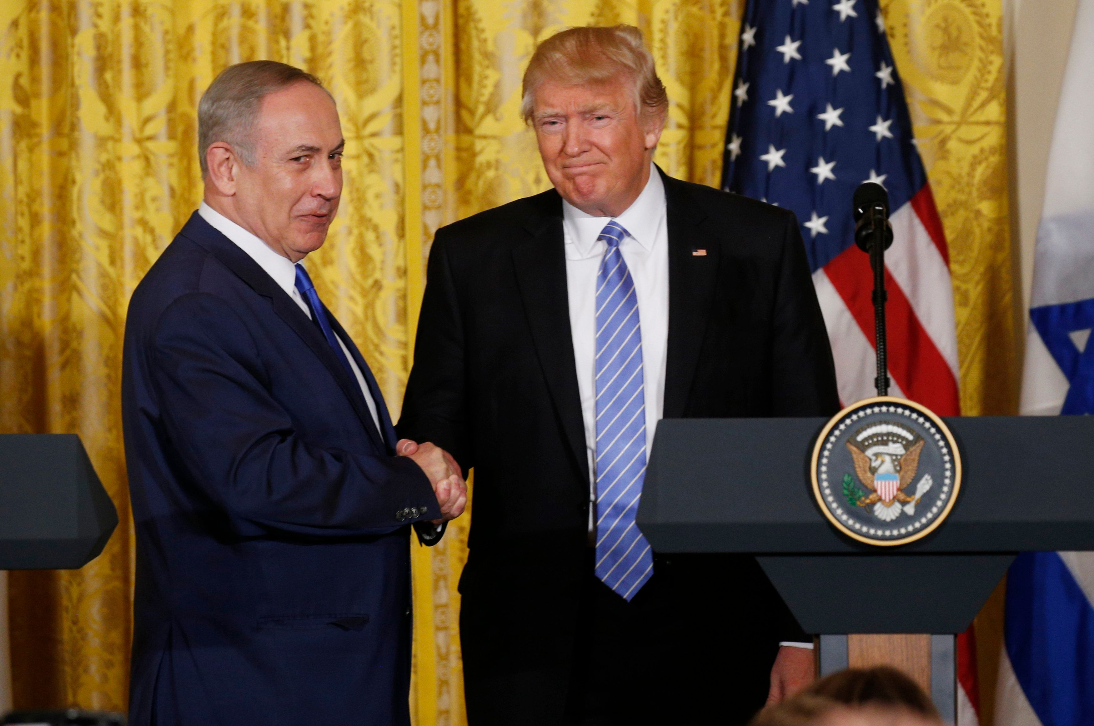 President Donald Trump greets Israeli Prime Minister Benjamin Netanyahu after a joint news conference at the White House on F