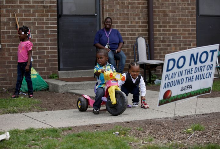 Residents of East Chicago, Indiana, like Nayesa Walker (center top) and her children were asked to leave their homes as testi