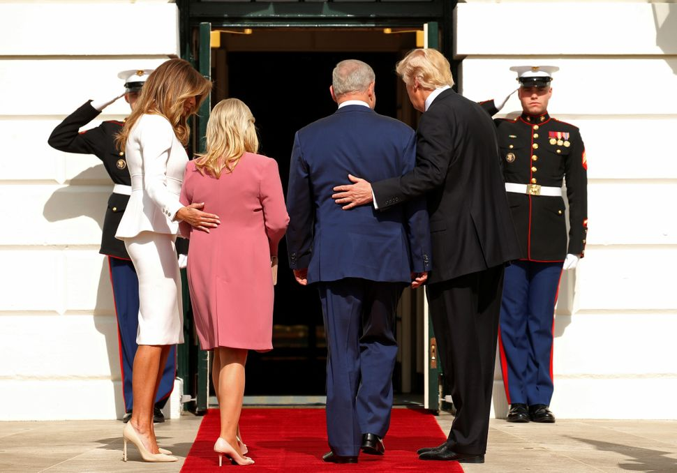 Donald Trump, right, and first lady Melania Trump, left, greet Israeli Prime Minister Benjamin Netanyahu and his wife, Sara,