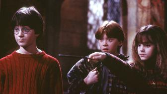"ATTENTION: THIS PICTURE HAS BEEN BINNED, DO NOT USE. - UNDATED PUBLICITY PHOTO -A scene from the first Harry Potter movie, ""Harry Potter and the Sorcerer's Stone,"" shows (L-R) Harry Potter played by Daniel Radcliffe, Oliver Wood played by Sean Biggerstaff and Hermione Grainger, played by Emma Watson. The film premieres in London November 4, 2001 and opens in the United States November 16. (CREDIT REUTERS/Peter Mountain/Warner Bros./Handout)"