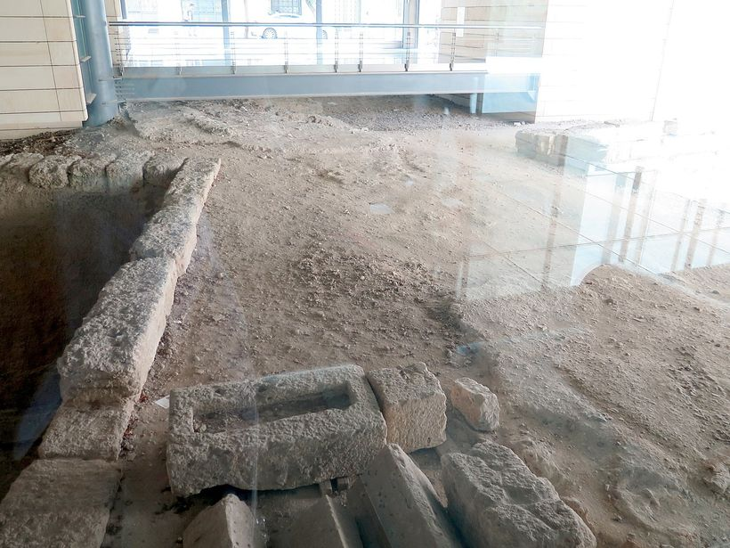 An office building puts glass floor over ruins of an ancient highway, exposed during the construction.