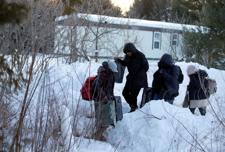 A family from Yemen crosses the U.S.-Canada border into Hemmingford, Quebec, on Feb.14, 2017.
