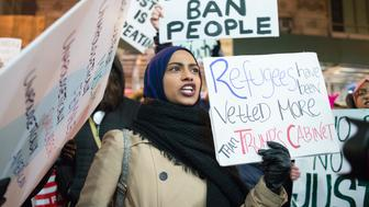 A woman in the crowd chants in opposition to the Muslim Ban in New York city, USA, on 11 February 2017. Protesters marched from Foley Sq to the offices of ICE (Immigration and Customs Enforcement) to protest what has been called the Muslim Ban.. (Photo by Shay Horse/NurPhoto via Getty Images)