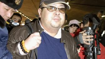 Kim Jong Nam arrives at Beijing airport in Beijing, China, in this photo taken by Kyodo February 11, 2007. Picture taken February 11, 2007. Mandatory credit Kyodo/via REUTERS ATTENTION EDITORS - THIS IMAGE WAS PROVIDED BY A THIRD PARTY. EDITORIAL USE ONLY. MANDATORY CREDIT. JAPAN OUT. NO COMMERCIAL OR EDITORIAL SALES IN JAPAN. THIS PICTURE WAS PROCESSED BY REUTERS TO ENHANCE QUALITY. AN UNPROCESSED VERSION HAS BEEN PROVIDED SEPARATELY.