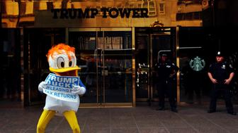 An activist by the name of DJ Quacker holds a sign asking Republican presidential nominee Donald Trump to release his tax forms, outside of Trump Tower in New York City, New York, U.S., September 6, 2016. REUTERS/Lucas Jackson