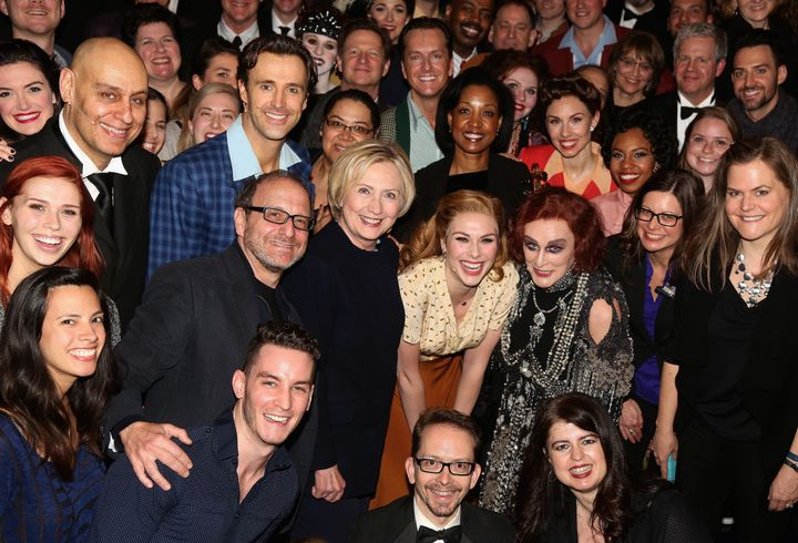 "Hillary Clinton and Glenn Close pose with ""Sunset Boulevard"" cast and orchestra backstage."