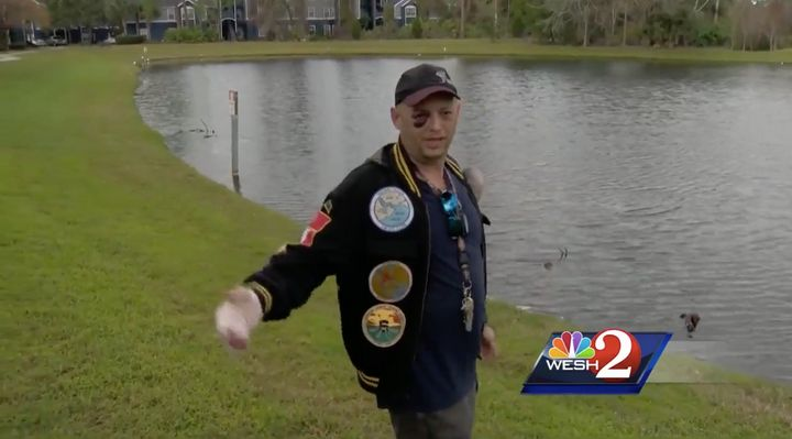 The 45-year-old Navy veteran stands near a Daytona Beach pond where he said three people violently killed a turtle.