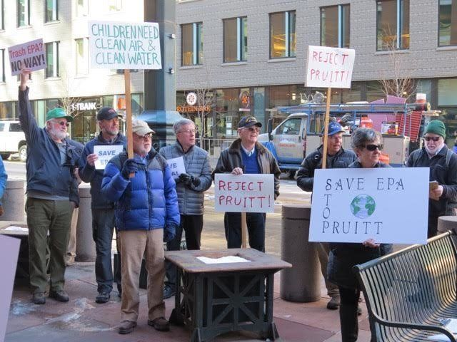 Former EPA Region 8 employees protest outside Sen. Michael Bennet's office.