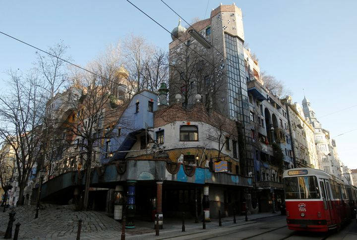 "The Hundertwasser House landmark, an apartment house designed by artist and architect Friedensreich Hundertwasser, with the ""Terrassencafe im Hundertwasserhaus"" is seen in Vienna, Austria, Feb.15."