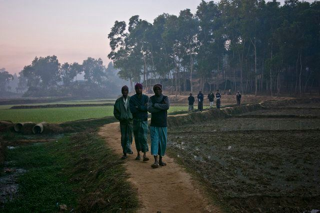 Walking down a road near the Kutapalong Rohingya refugee camp in Cox's Bazar.