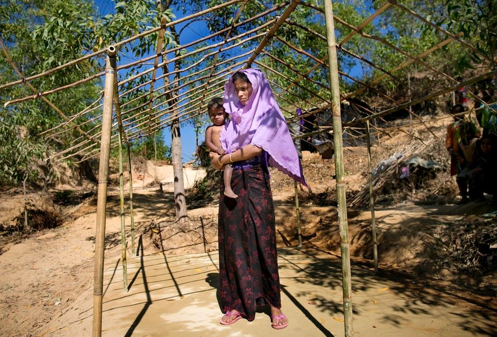 Hasina Begum in the house she is building in Balu Kali refugee camp. She says she doesn't have enough money to finish b