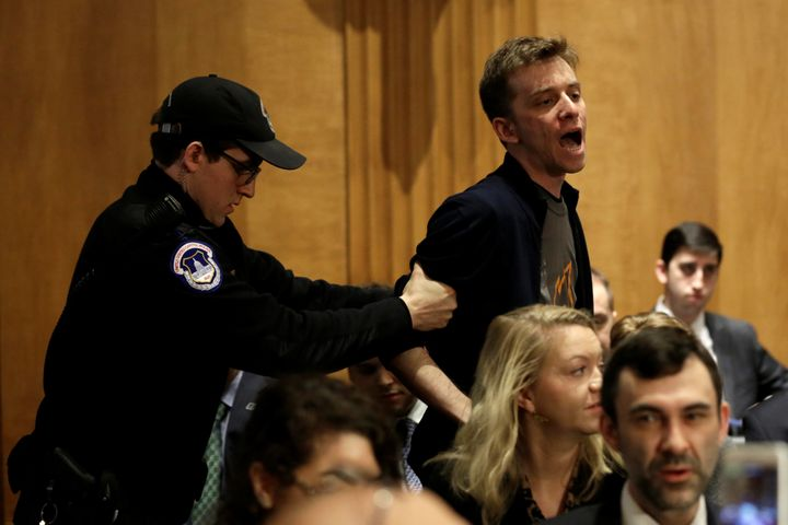 Police remove a protester during the Senate Foreign Relations Committee hearing on David Friedman's nomination.