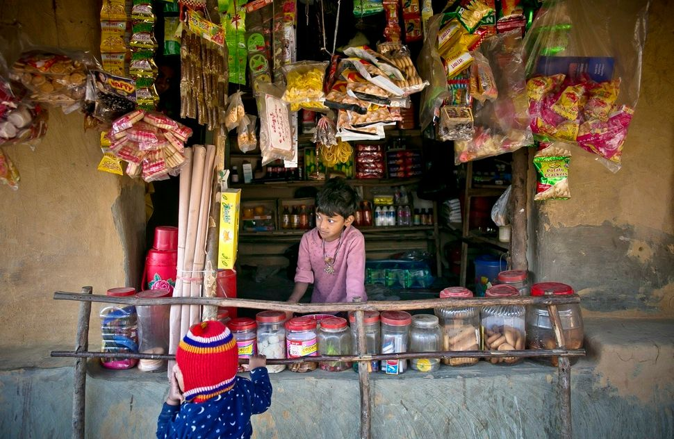 A young boy works at a shop in Kutapalong.