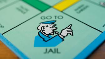 The 'Go To Jail' square is seen on a Hasbro Inc. Monopoly board game arranged for a photograph taken with a tilt-shift lens in Oradell, New Jersey, U.S., on Sunday, June 28, 2015. Photographer: Ron Antonelli/Bloomberg via Getty Images