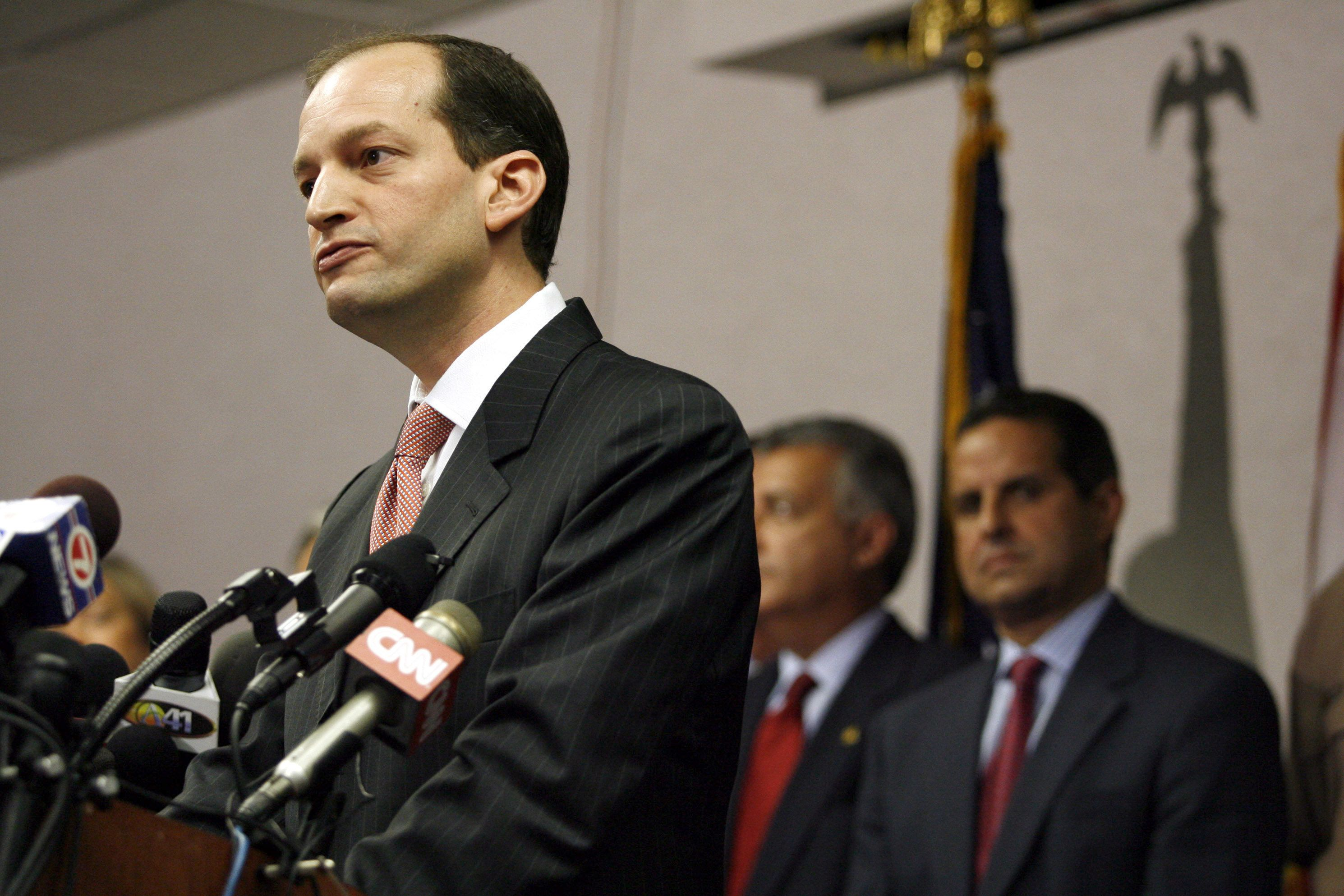 U.S. Attorney R. Alexander Acosta (L) holds a news conference about the arrest of seven people in Miami, Florida, June 23, 2006. The seven people arrested in Miami discussed attacks on the landmark Sears Tower in Chicago, the FBI building in Miami and other government buildings, U.S. officials said on Friday. Also in attendance was City of Miami Mayor Manny Diaz (R). REUTERS/Marc Serota  (UNITED STATES)