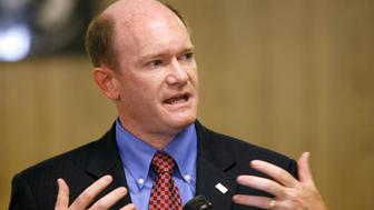 Delaware Democratic senatorial candidate Chris Coons gestures as he speaks during a campaign event in Newark, Delaware October 29, 2010. Coons will face Republican Senatorial Candidate Christine O'Donnell in the November 2 election.  REUTERS/Tim Shaffer (UNITED STATES - Tags: POLITICS)