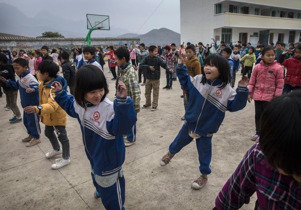 Luo Hangni, 11, right, does exercises with classmates at a local school. Local schools, educators and community charities oft