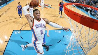 OKLAHOMA CITY, OK - FEBRUARY 15:  Russell Westbrook #0 of the Oklahoma City Thunder goes up for a dunk during a game against the New York Knicks on February 15, 2017 at Chesapeake Energy Arena in Oklahoma City, Oklahoma. NOTE TO USER: User expressly acknowledges and agrees that, by downloading and/or using this photograph, user is consenting to the terms and conditions of the Getty Images License Agreement. Mandatory Copyright Notice: Copyright 2017 NBAE (Photo by Layne Murdoch/NBAE via Getty Images)