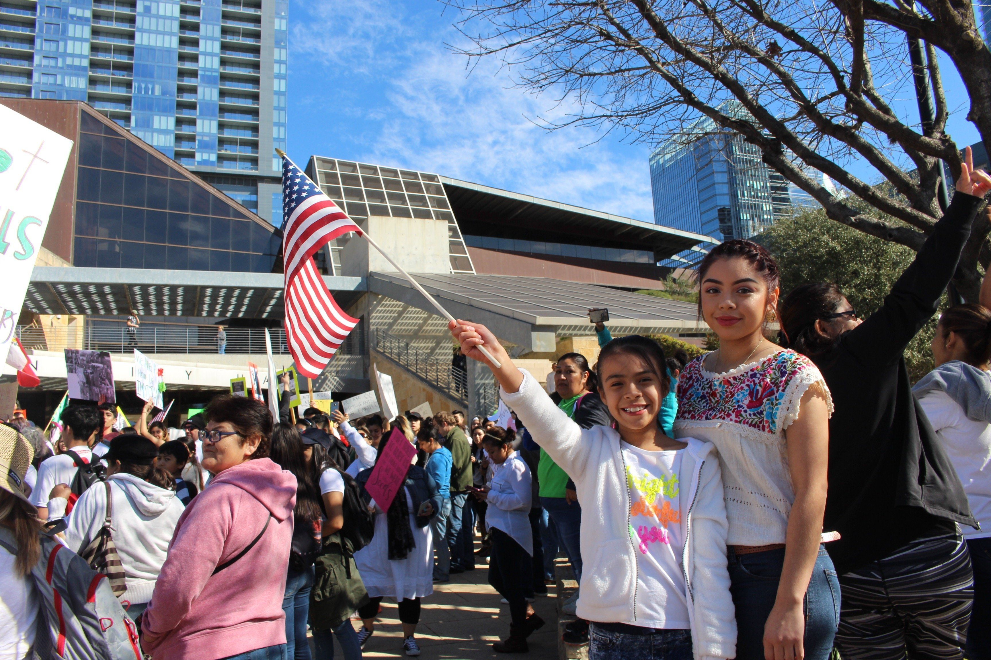 Noemí, 17, waved an American flag with her younger sister in front of Austin City Hall on Feb. 16, 2017, at a demonstr