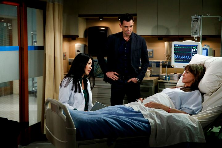 """<p>Scene from Feb. 16 episode of """"The Young & The Restless,"""" featuring Jill (Jess Walton) in bed and son Billy Abbott (Jason Thompson) looking on as her doctor discusses needed lifestyle changes. </p>"""