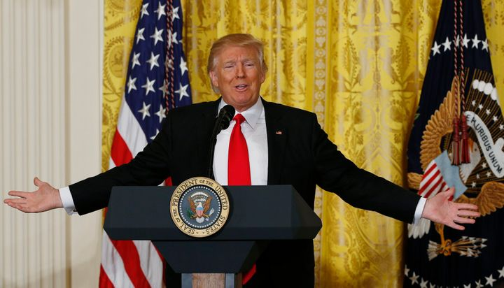 President Donald Trump reacts to a question during a news conference at the White House on Feb. 16.