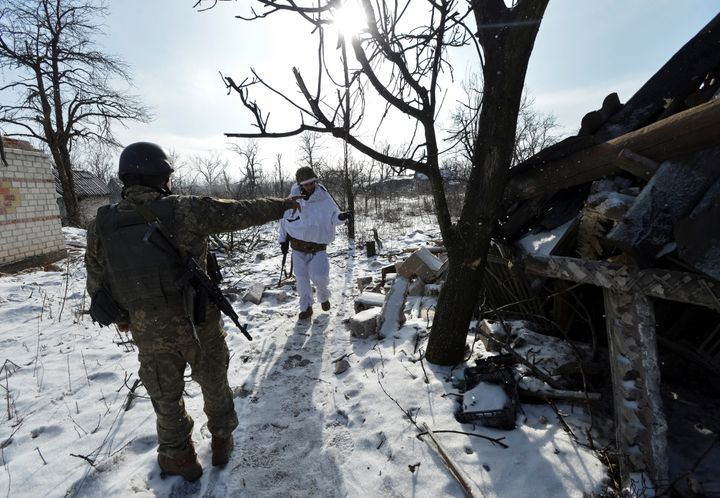Ukrainian servicemen gather at their position on the front line near the government-held town of Avdiyivka, Ukraine, on Feb.