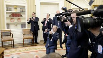 WASHINGTON, D.C. - FEBRUARY 14:  (AFP-OUT) White House Press Secretary Sean Spicer (C) and New Jersey Governor Chris Christie (2nd L) take pictures as U.S. President Donald Trump signs H.J. Res. 41 in the Oval Office of the White House on February 14, 2017 in Washington, DC. The resolution nullifies a rule in the Dodd-Frank Act that 'requires resource extraction issuers to disclose payments made to governments for the commercial development of oil, natural gas, or minerals.' (Photo by Olivier Douliery-Pool/Getty Images)
