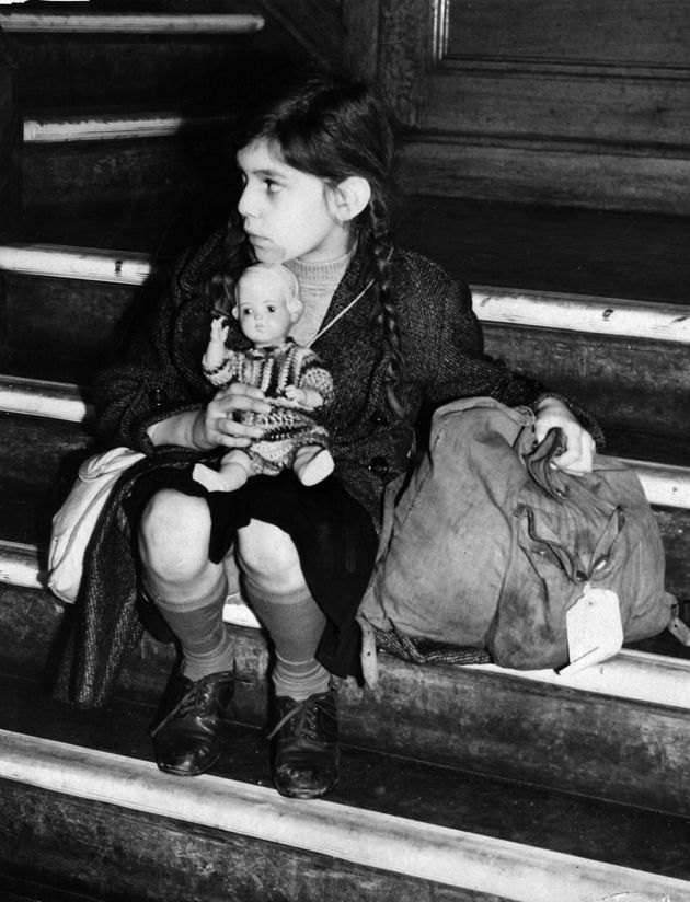 An 8-year-old Jewish refugee from Germany arrives in Harwich, England, via the Kindertransport program...