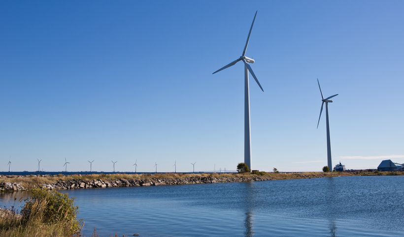 Two of seven older 600 MW Bonus wind turbines on Lynetten in the Copenhagen harbor. In the background are some of the 20 2 MW