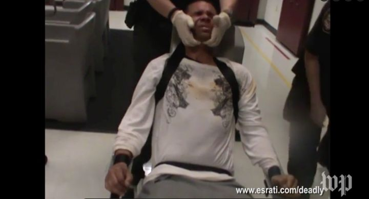 After being sprayed in his face, Wade, who was already strapped into the chair, was seen being held down by correctional