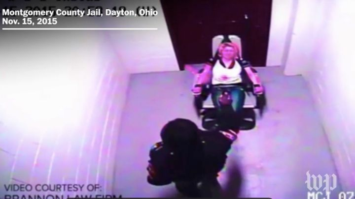 Back in 2015, a 25-year-old woman named Amber Swink was filmed being pepper-sprayed while in similar restraints.
