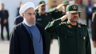 TEHRAN, IRAN - SEPTEMBER 15:  Iranian President Hassan Rouhani (L) and IRGC Major General Mohammad Ali Jafari (R) attend the 21st Nationwide Assembly of the Islamic Revolution Guards Corps (IRGC) Commanders in Tehran, Iran on September 15, 2015. (Photo by Pool/Iranian Presidency Press Office/Anadolu Agency/Getty Images)