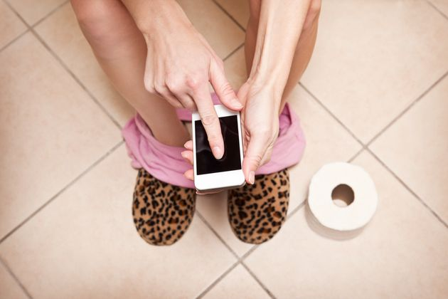 Using Your Phone On The Toilet Could Be Making You (And Your Kids)