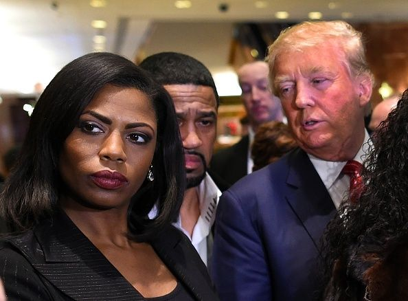 "Omarosa Manigault, a contestant on the first season of ""The Apprentice,"" appears with Donald Trump on November 30, 2015 after"