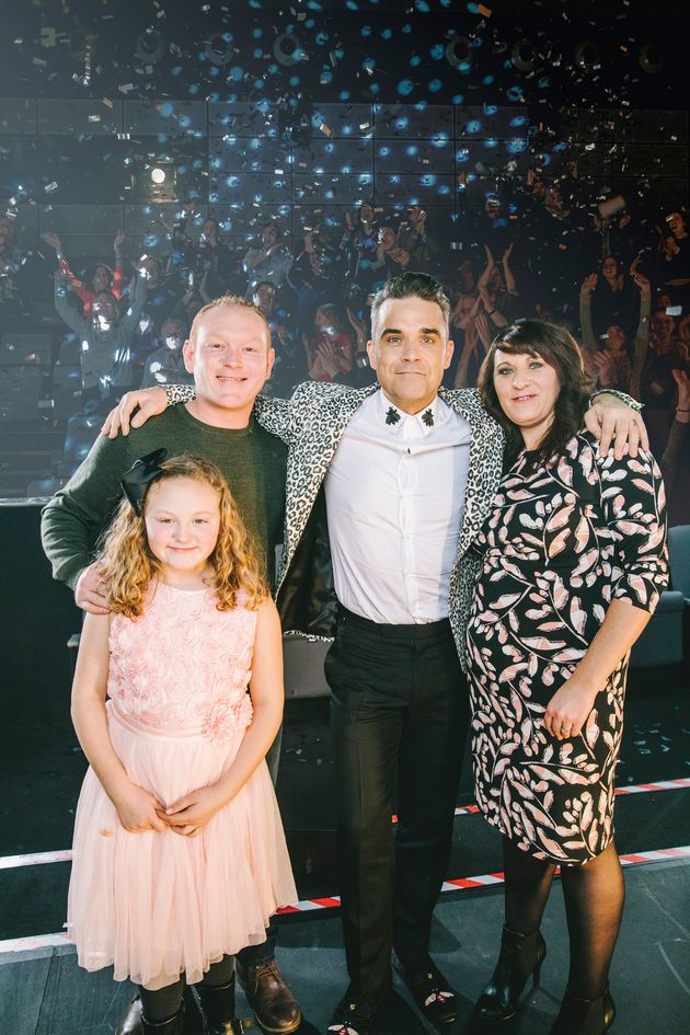Robbie made one fan and her family very, very happy with a surprise visit to