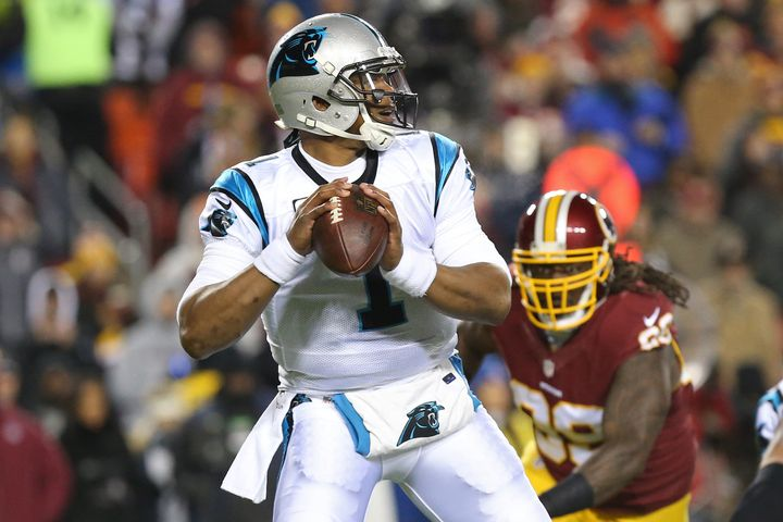 Jean Francois eyes 2015 NFL MVP Cam Newton during a game last season.