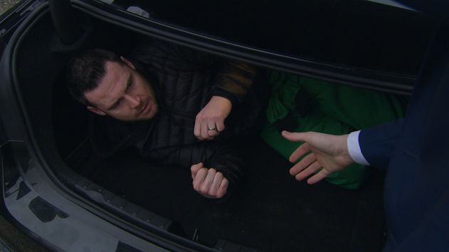 Aaron ends up in the boot of the car, just before Robert's planned