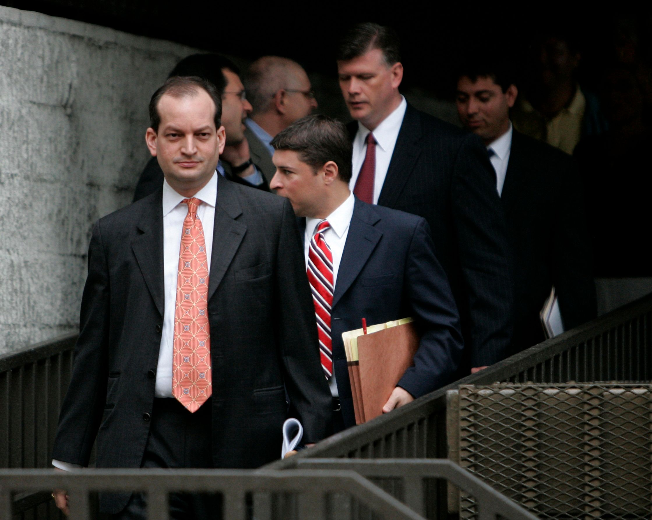 R. Alexander Acosta, United States Attorney (L) exits U.S. District Court with other attorneys at U.S. District Court in Fort Lauderdale, Florida June 19, 2008, where Bradley Birkenfeld, a former UBS AG banker, pleaded guilty to charges of conspiring to help an American billionaire to evade taxes.     REUTERS/Joe Skipper  (UNITED STATES)