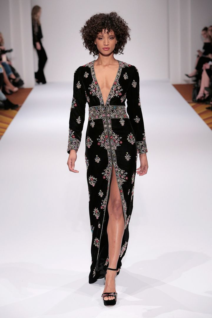 """Hill designs beautiful, if tame, prom dresses and gowns, so I wouldn't be seeing a poor take on <a href=""http://www.chron.com/life/style/fashion/article/Best-and-worst-of-NYFW-10929041.php#photo-12364106"" target=""_blank"">Donald Trump's 'MAGA' hat in sweater form</a>,"" -Andy Campbell"