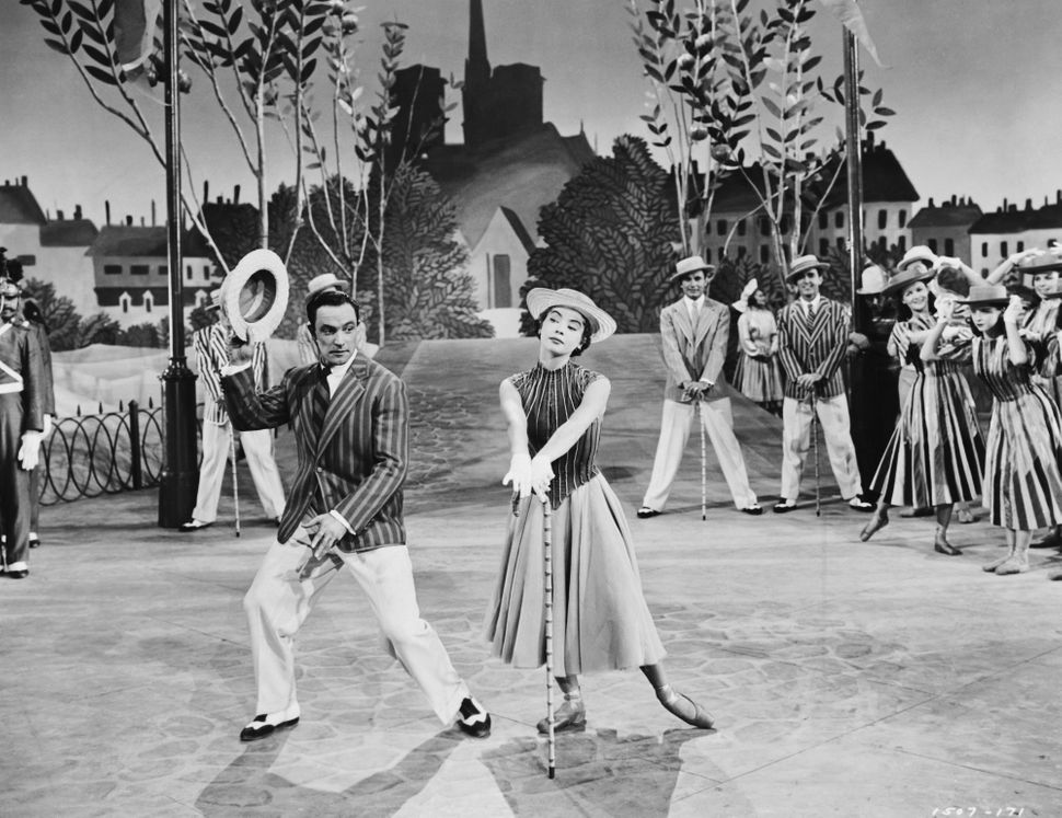 Gene Kelly dances with Leslie Caron.