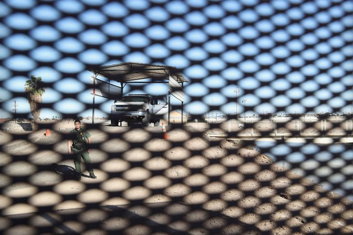 A U.S. Border Patrol agent stands at the U.S.-Mexico border fence on November 17, 2016 at San Luis, Arizona. Border prot