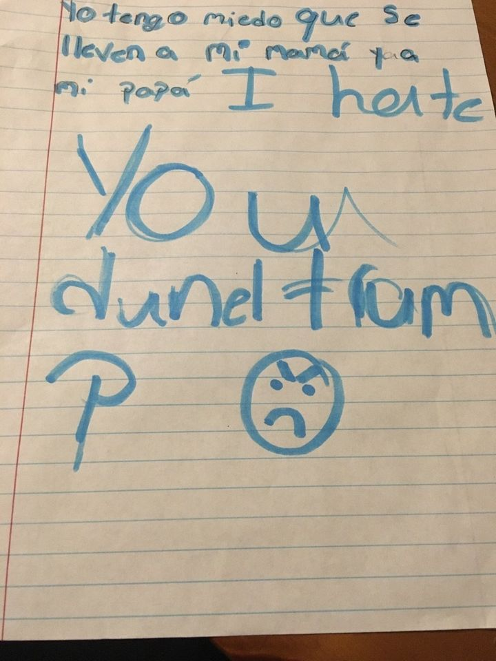 An elementary school student in Austin, Texas, submits a writing prompt after a series of immigration arrests in February 201