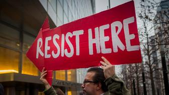 NEW YORK CITY, NEW YORK, UNITED STATES - 2017/01/17: With Donald Trump choosing 6 Goldman Sachs veterans for his administration, dozens of activists, on January 17, converged at the Goldman headquarters in Manhattan, to occupy and protest the continuing relationship with the White House and the Wall Street giant. (Photo by Michael Nigro/Pacific Press/LightRocket via Getty Images)